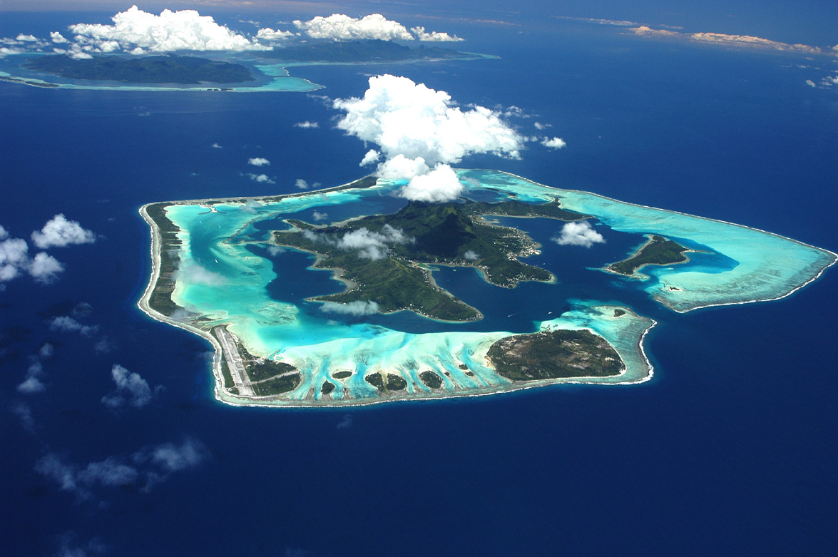 11. Bora Bora as seen from the air.  The pass through the coral reef can be seen in the lower right hand side of the picture.  This photo is from Bora-Bora, amriholiday.blogspot.com.