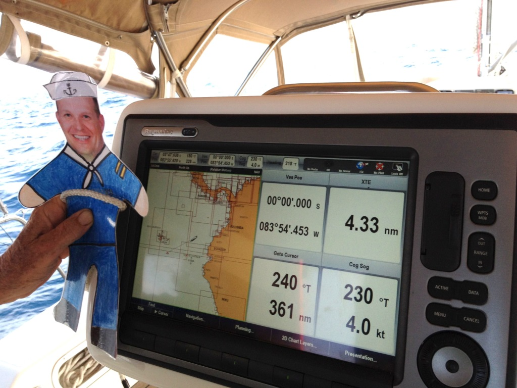 19. Flat Mr. Davis posed with Joyful's chart plotter to show you the exact moment Joyful crossed the Equator with Jeff, Anne, and Bill also on board!.  Please see the latitude and longitude reading!