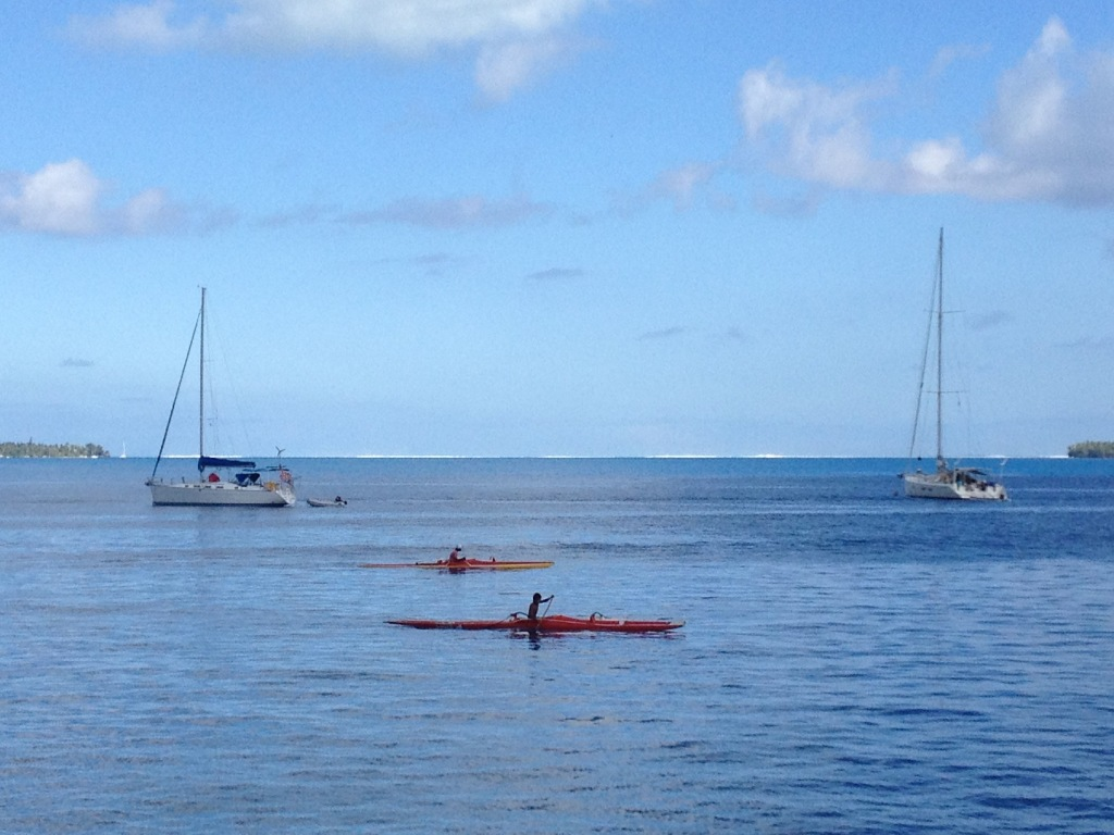 19. Ocean waves crashing onto Bora Bora's coral reef and outrigger canoes gliding by in the lagoon were a common sight from Joyful.