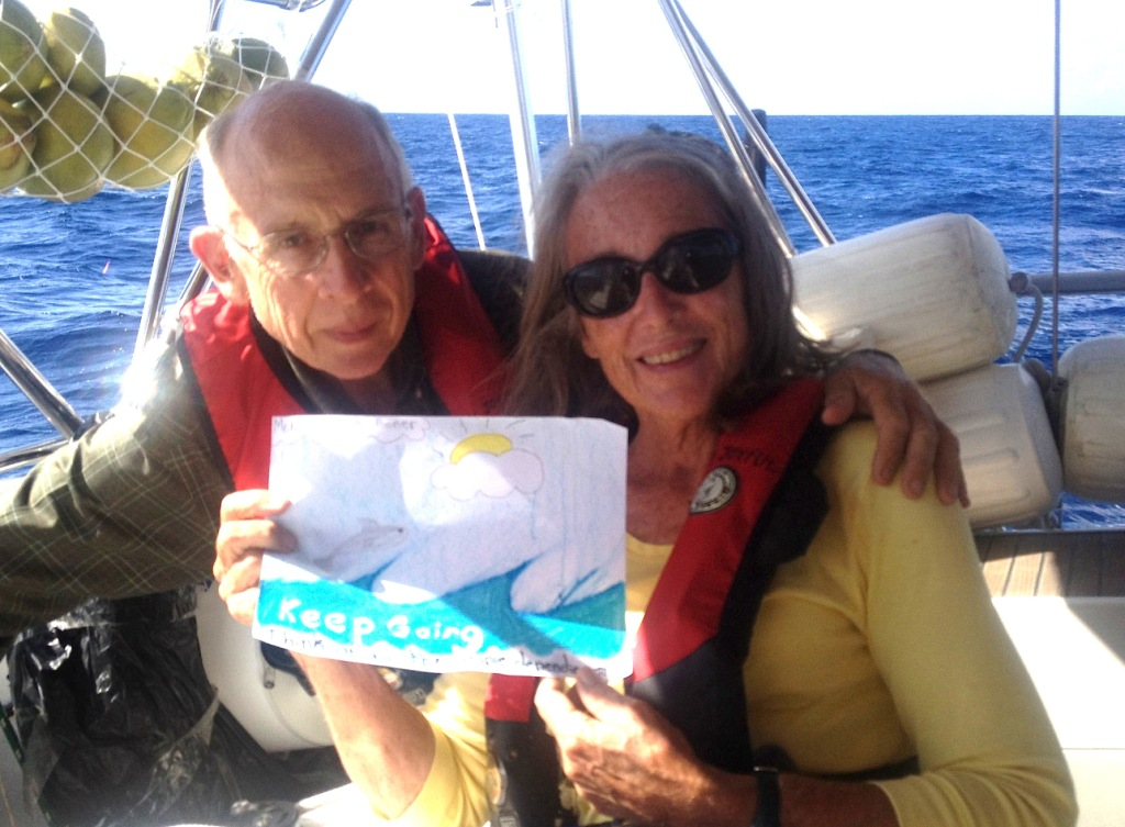 2. Jeff and Anne opened a colorful handmade card made for us by a thoughtful Round Hill Elementary School student.  We opened it to celebrate the start of Joyful's passage from Nuku Hiva to Bora Bora.  We liked it!  Thank you!