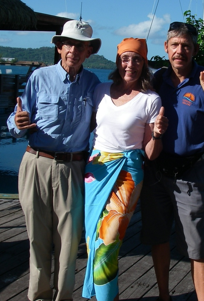 36. Jeff, Anne & Luc, the wonderful rally cooridinator for the Blue Planet Odyssey, greeted one another in Bora Bora. Luc brought Anne a present from Jimmy, which is the beautiful scarf made of high tech UV blocking fabric.  Thank you Jimmy and Luc!