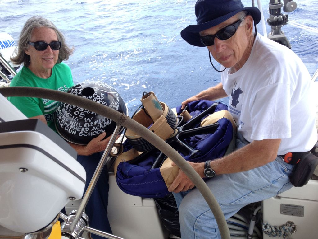 39. From Joyful's stern, Jeff and Anne prepared to deploy the NOAA drifter buoy into the South Pacific Ocean.