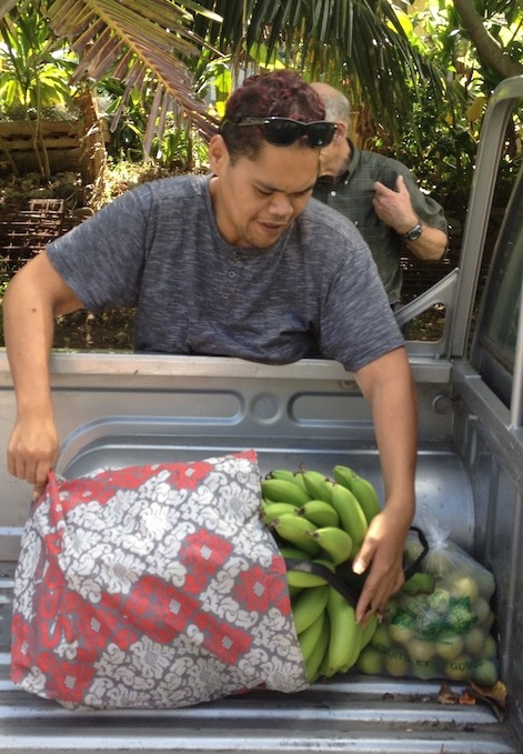 44. Emmanuel loaded his truck with the bananas, pamplemousse, and limes Conchita graciously gave us.  Thank you both!