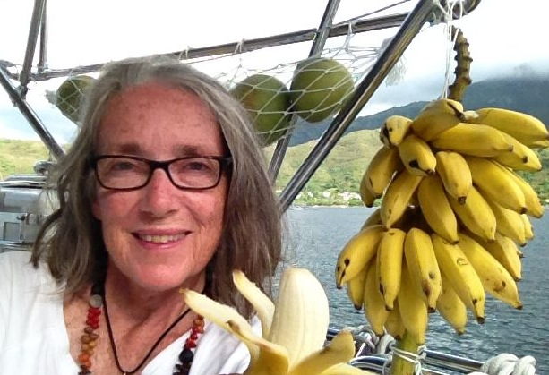49. Anne with the Nuku Hiva bananas the kind stranger by the dock gave us just to be nice to us.  Thank you kind, unforgettable lady!