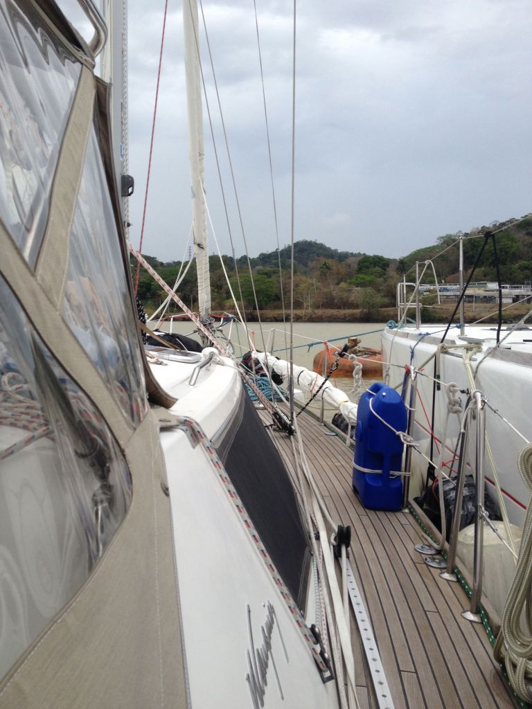 49. Joyful, the catamaran, & Aventura rafted together, then waited at a mooring, before they entered the Pedro Miguel lock