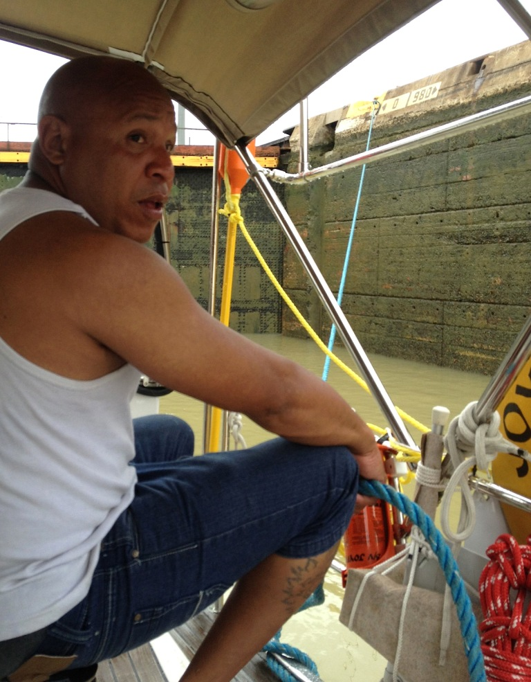 79. Joyful's line handler payed out some floating line as the water level in upper Miraflores Lock lowered.