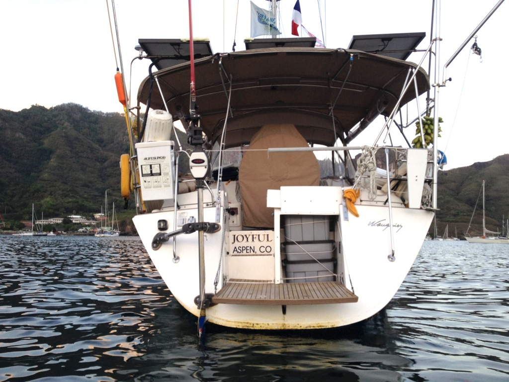 8. We lowered Joyful's swim platform in Nuku Hiva to enter and exit her inflatable dinghy, which is her going ashore boat that has oars and a 6 hp engiine.  You can see some of the sea growth on her transom caused by 40 days at sea.