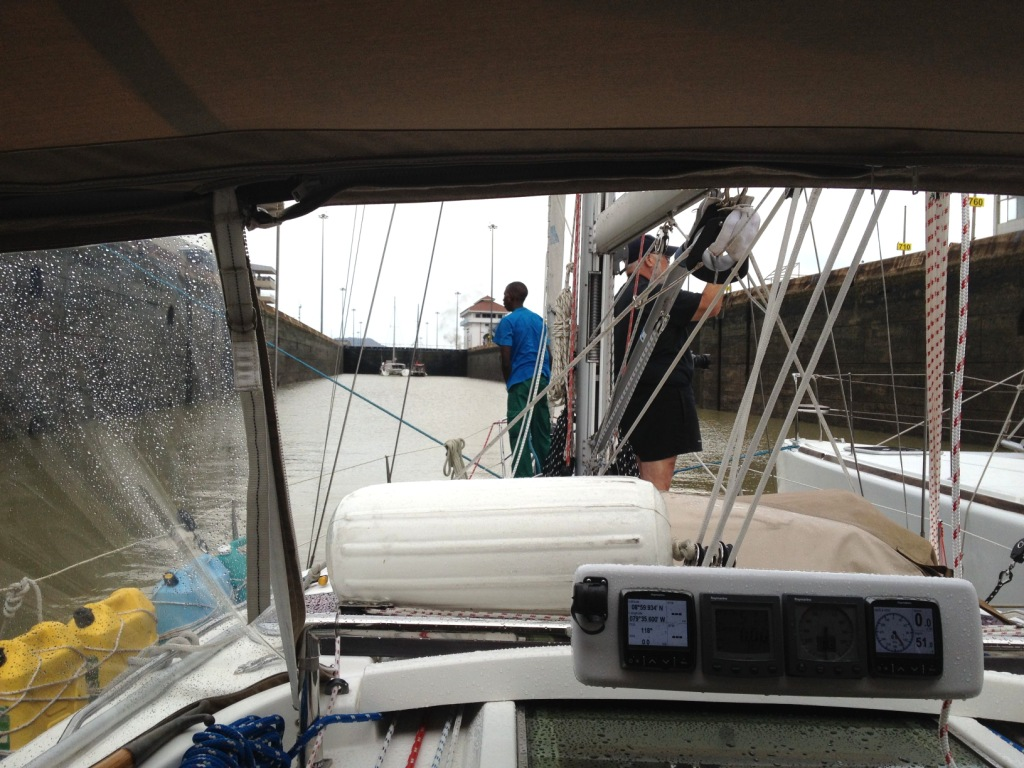 80. Bill and a line handler stood on Joyful's bow as the water level lowerd in the upper Miraflores Lock in the Panama Canal.