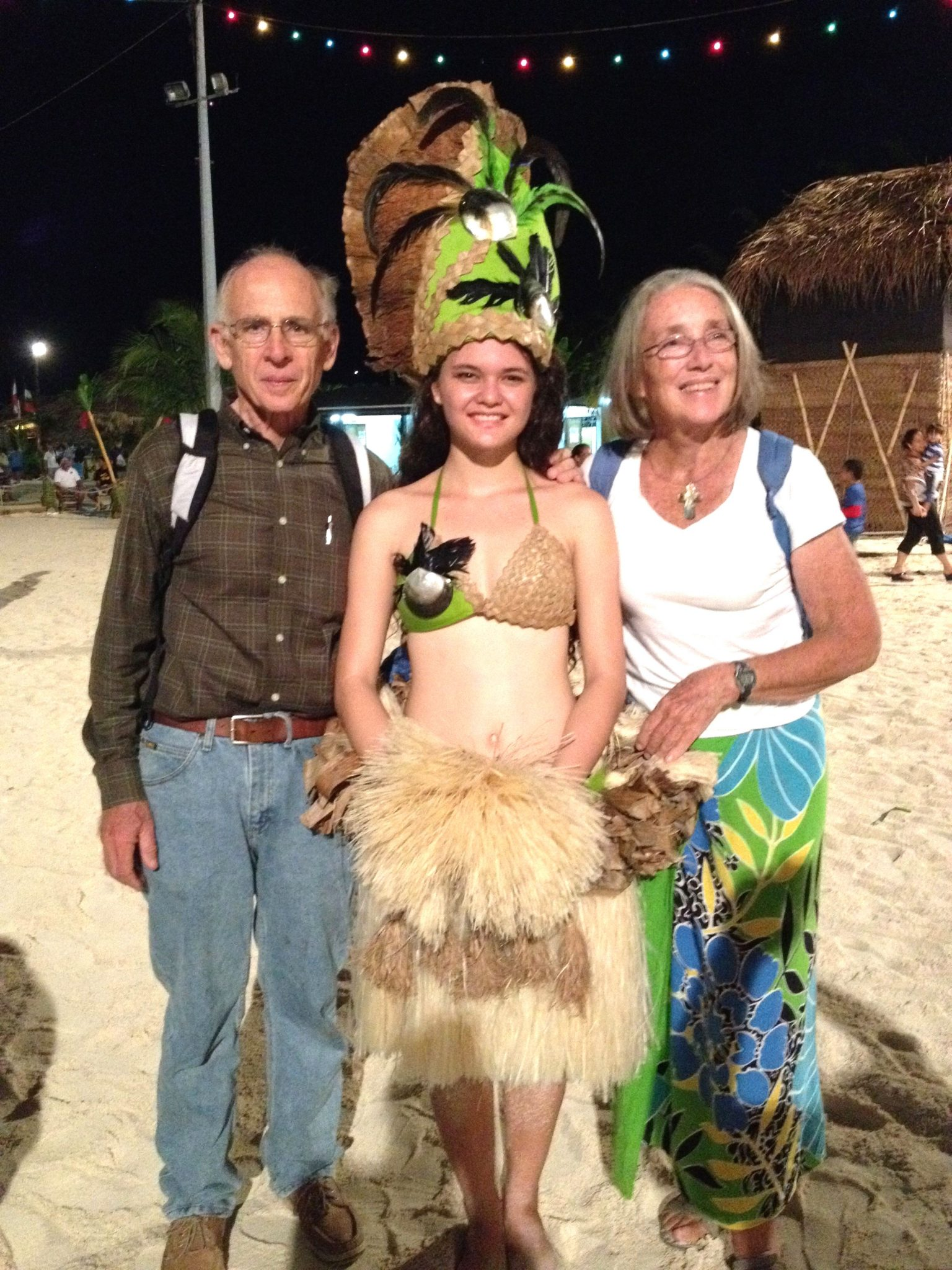 11. The pretty Faanui dancer poses with Jeff and Anne at the Bora Bora Heiva 2015