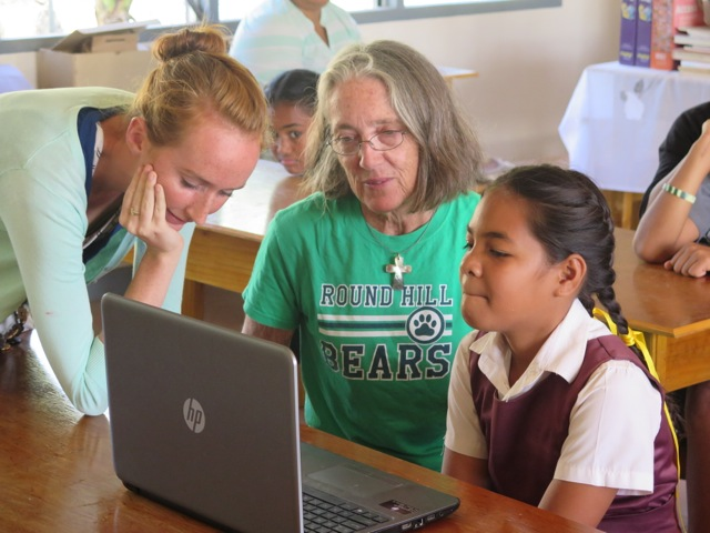 122. A student from the Vava'u Side School, Katie from the Peace Corp, Anne from the BPO and Mission Joyful, participate in a Skype session with the Round Hill Elementary School Bears. The students may form lifelong friendships with one another!