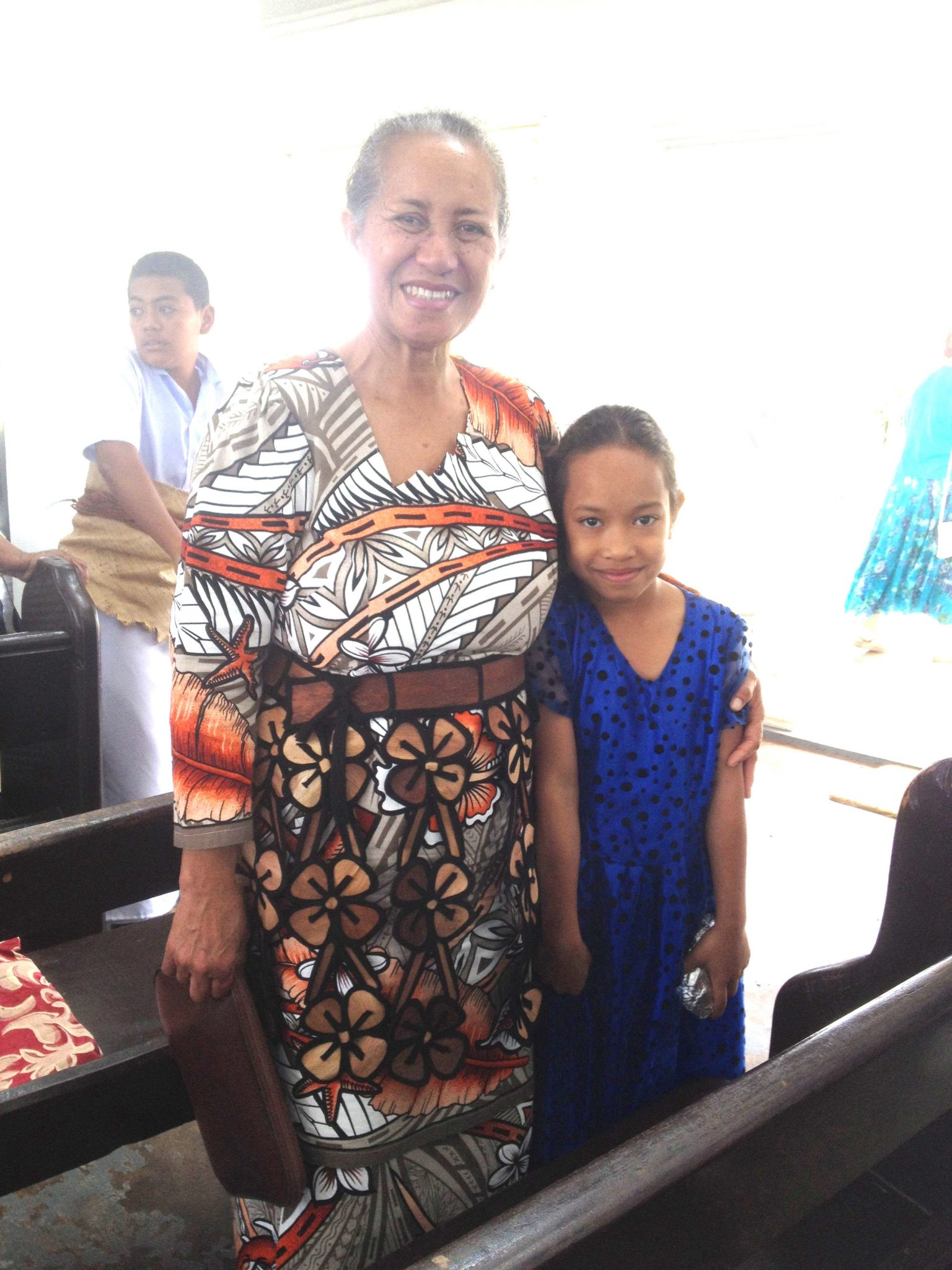13. This beautiful Tongan grandmother and granddaughter attended the Wesleyan Church service together. The Tongan woman is wearing a woven sash indicating allegance to the crown.