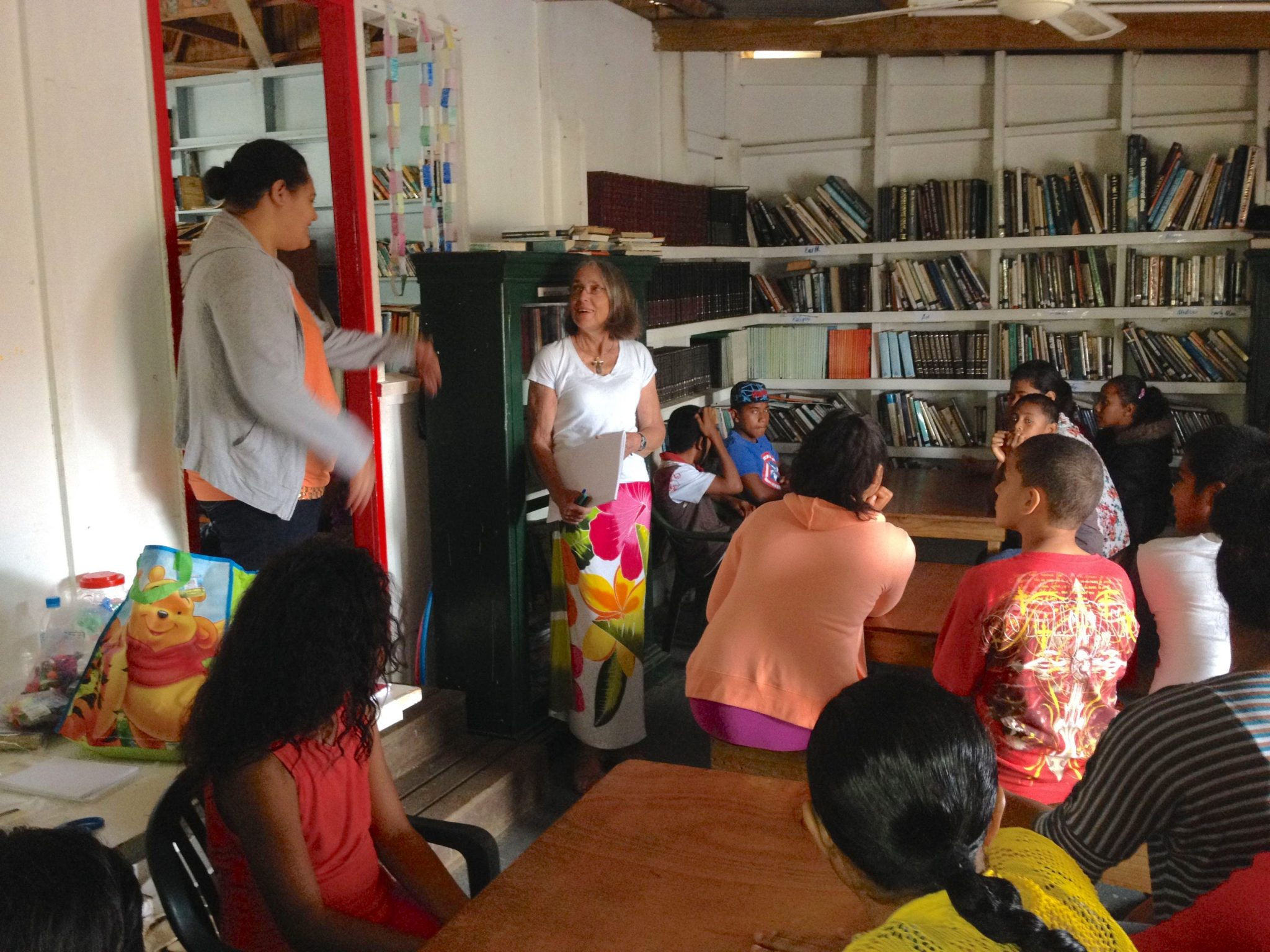 136. Abby, the Tongan librarian, explained to me that she would translate for the younger children, who had not yet learned English in school. I had to stand in the dorway between both rooms to begin the instruction!.jpg