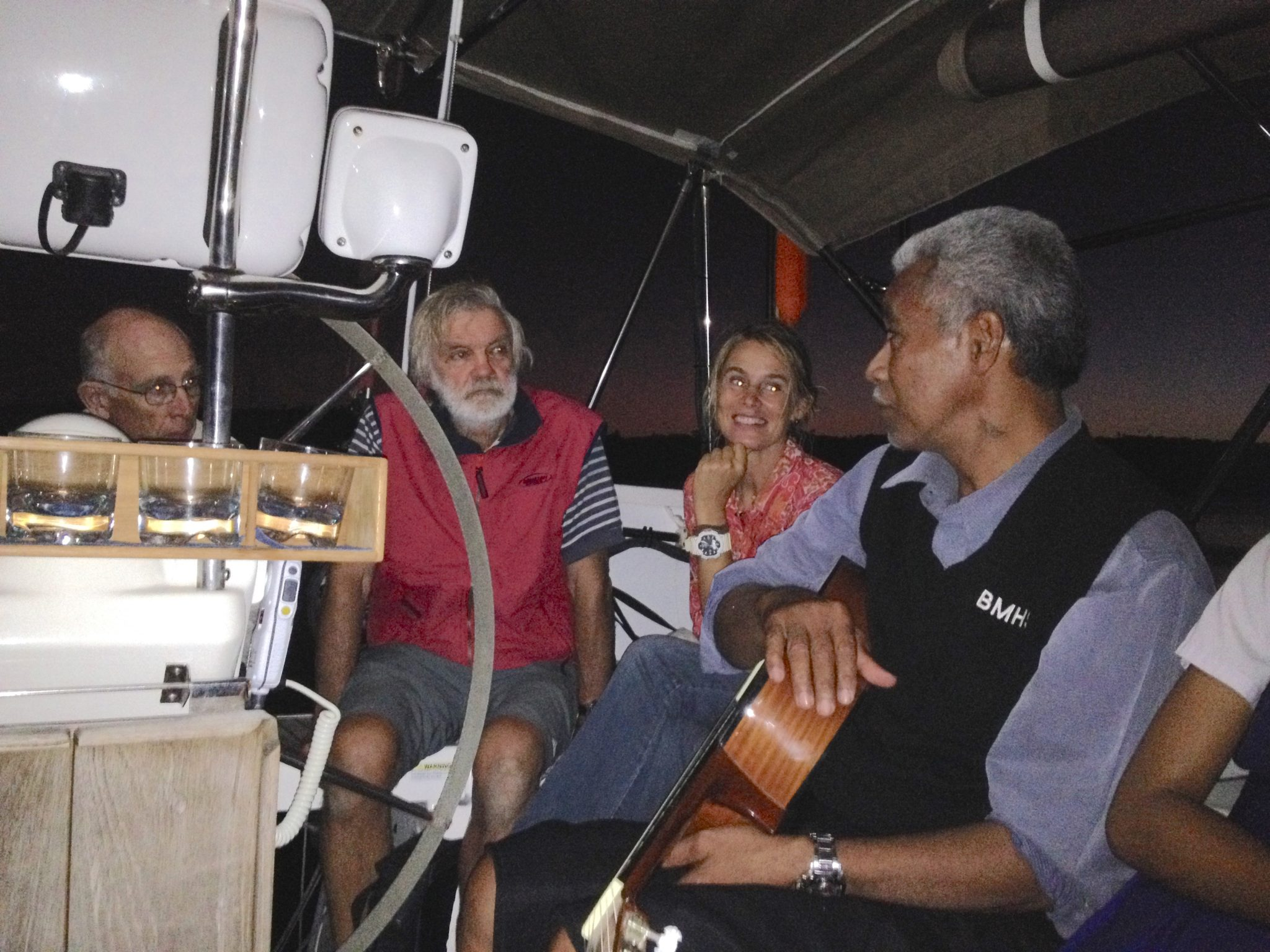 163. From left to right - Jeff, sailing missionaries Phil and Beatrice, Tongan Soakai discuss life on Tonga