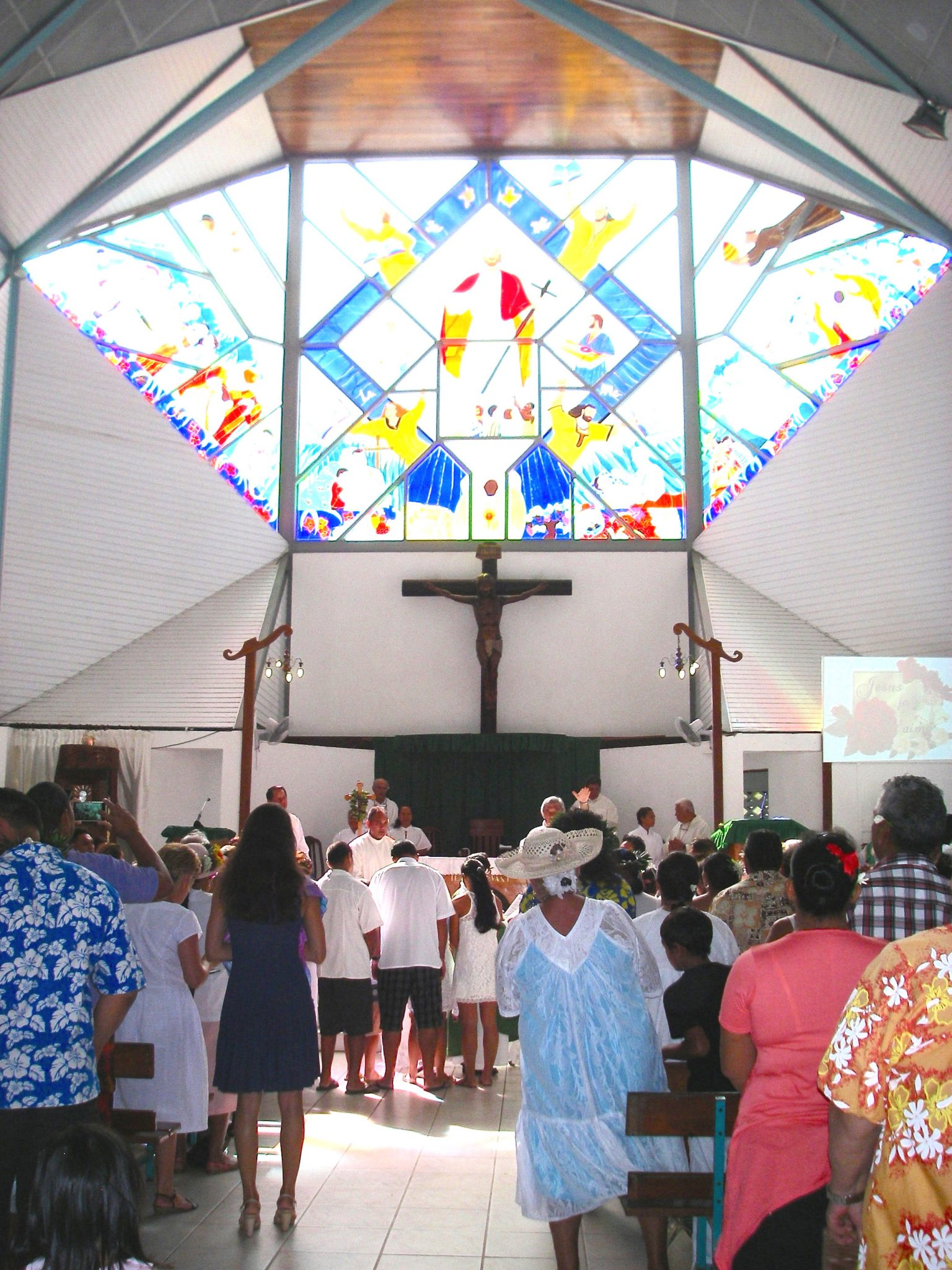 32. We had the honor to attend many rites of holy baptism at a Bora Bora church