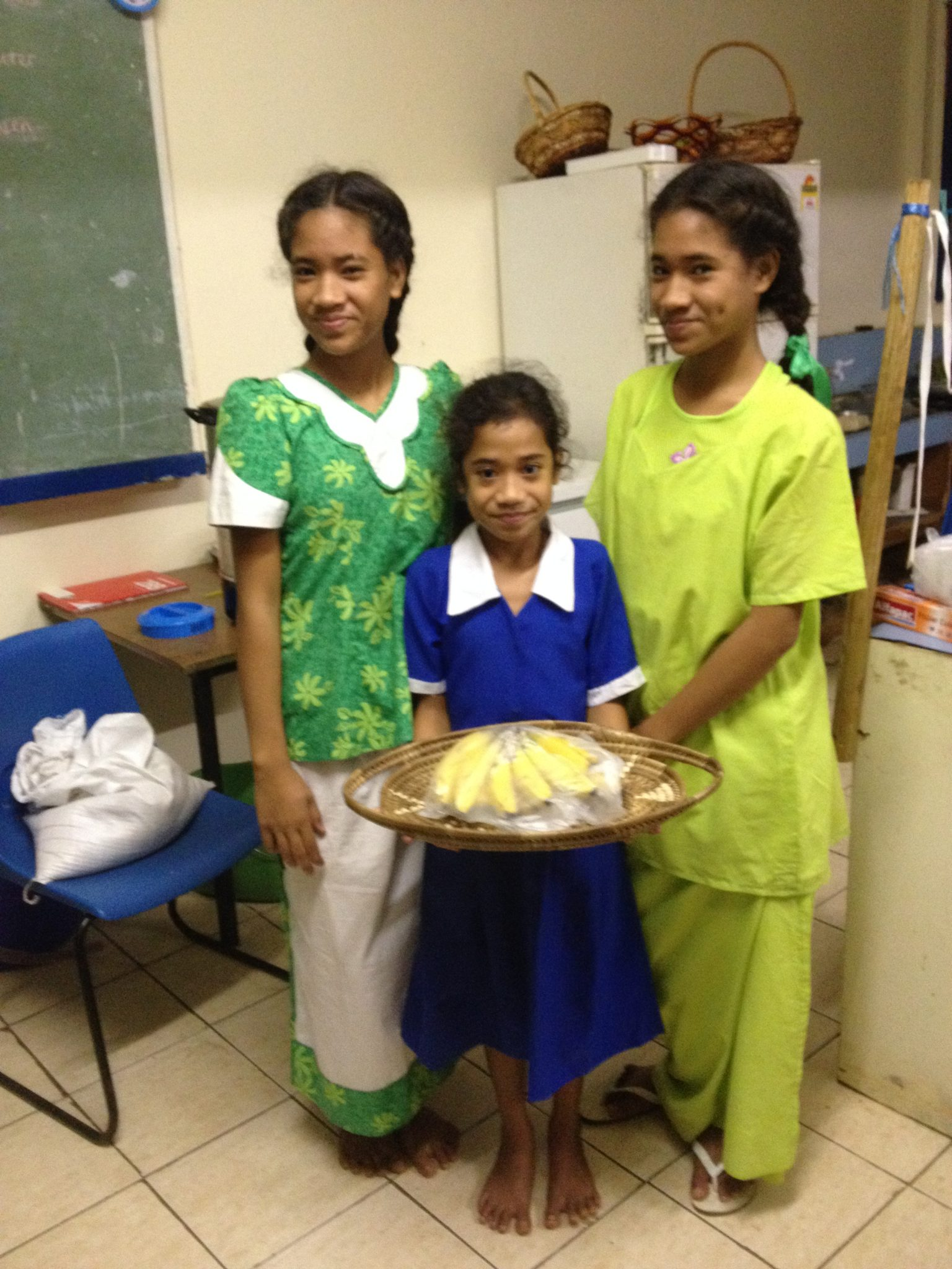 37. These beautiful Tongan sisters, Kilisitina, Otolose, Tiara, and their parents gave us a wonderful woven basket full of bananas. They made the basket in school!