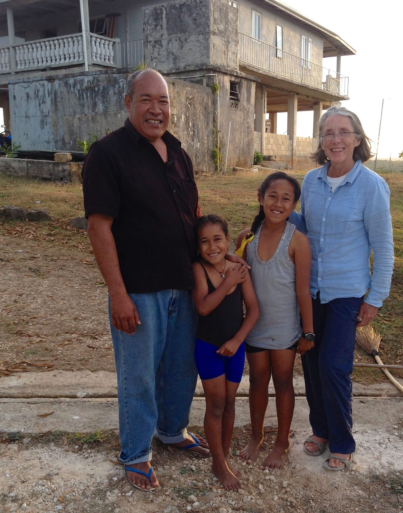 39. Anne with new Tongan friends, Peno, 'Ala, and Angelina. Land is usually handed down through generations in Tonga. Their home overlooks the gorgeous sea