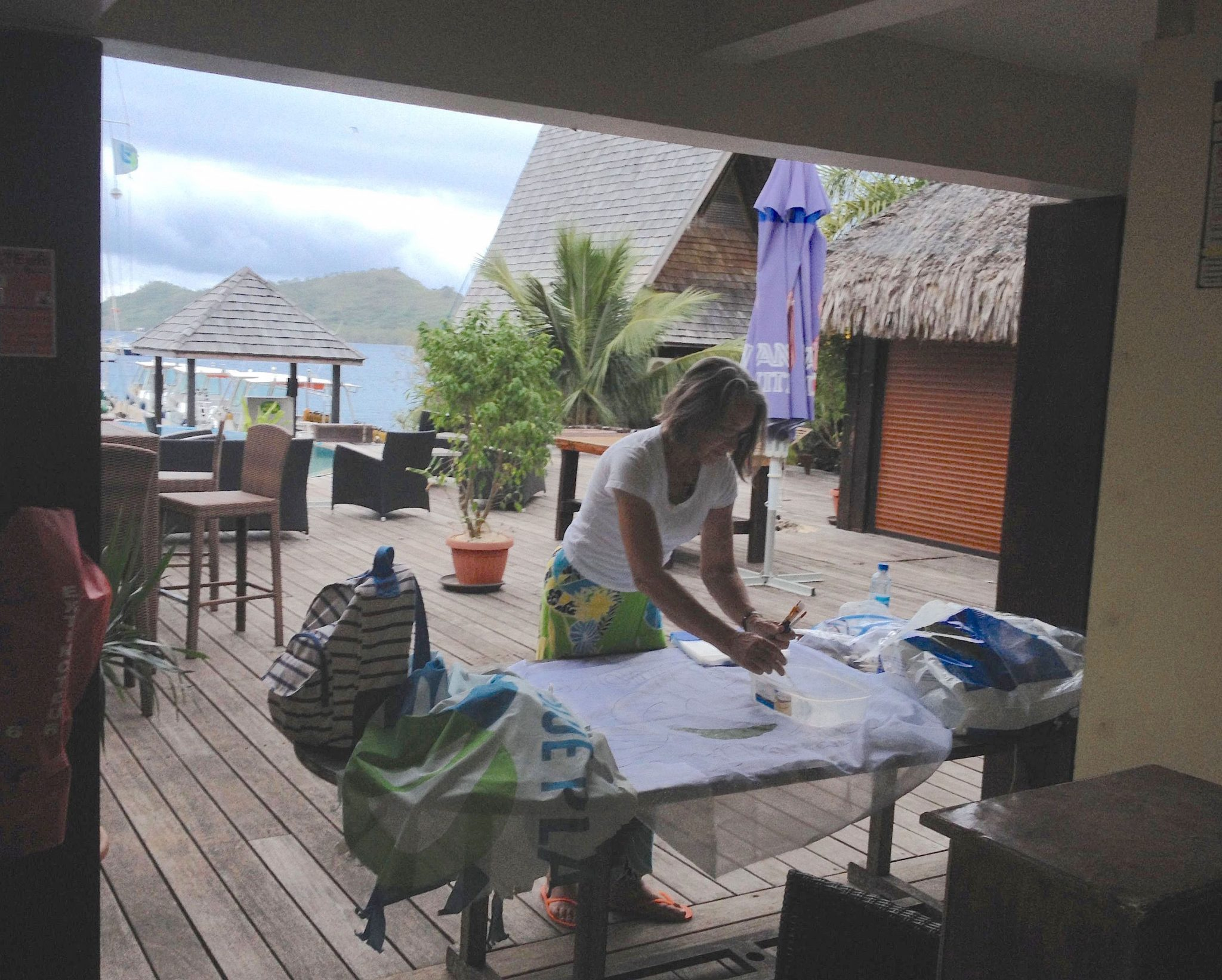 43. Anne paintied Joyful's new Blue Planet Odyssey flag on the veranda of the MaiKai Restaurant and Yacht Club in Bora Bora.