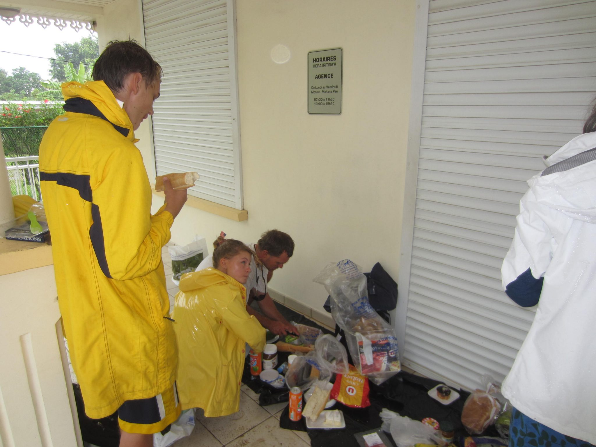 47. During a rainstorm, Sailors for Christ members enjoyed a feast and a banana split together to celebrate the 4th of July on the porch of a Bora Bora bank.