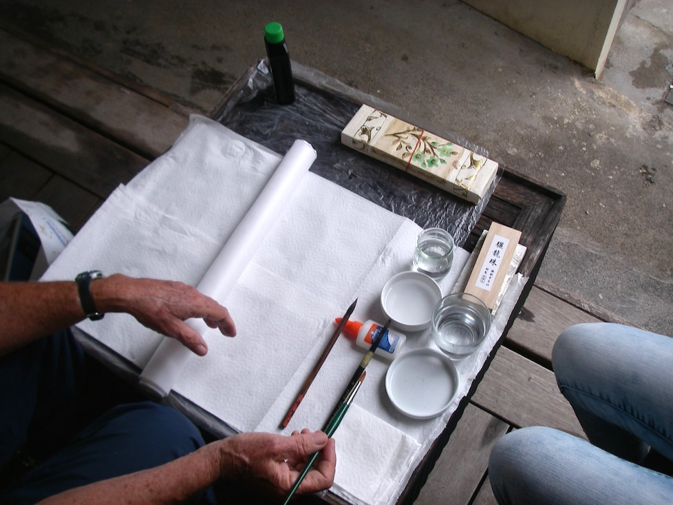 56. Anne demonstrated how to set up the painting area for Chinese brush painting.  The glue was only used as a brush rest