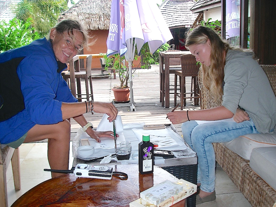 58. Fellow sailing missionaries, Beatrice and Gabriella, learn Chinese brush painting from me in an art ministry workshop in at the MaiKai Restaurant and Yacht Club in Bora Bora