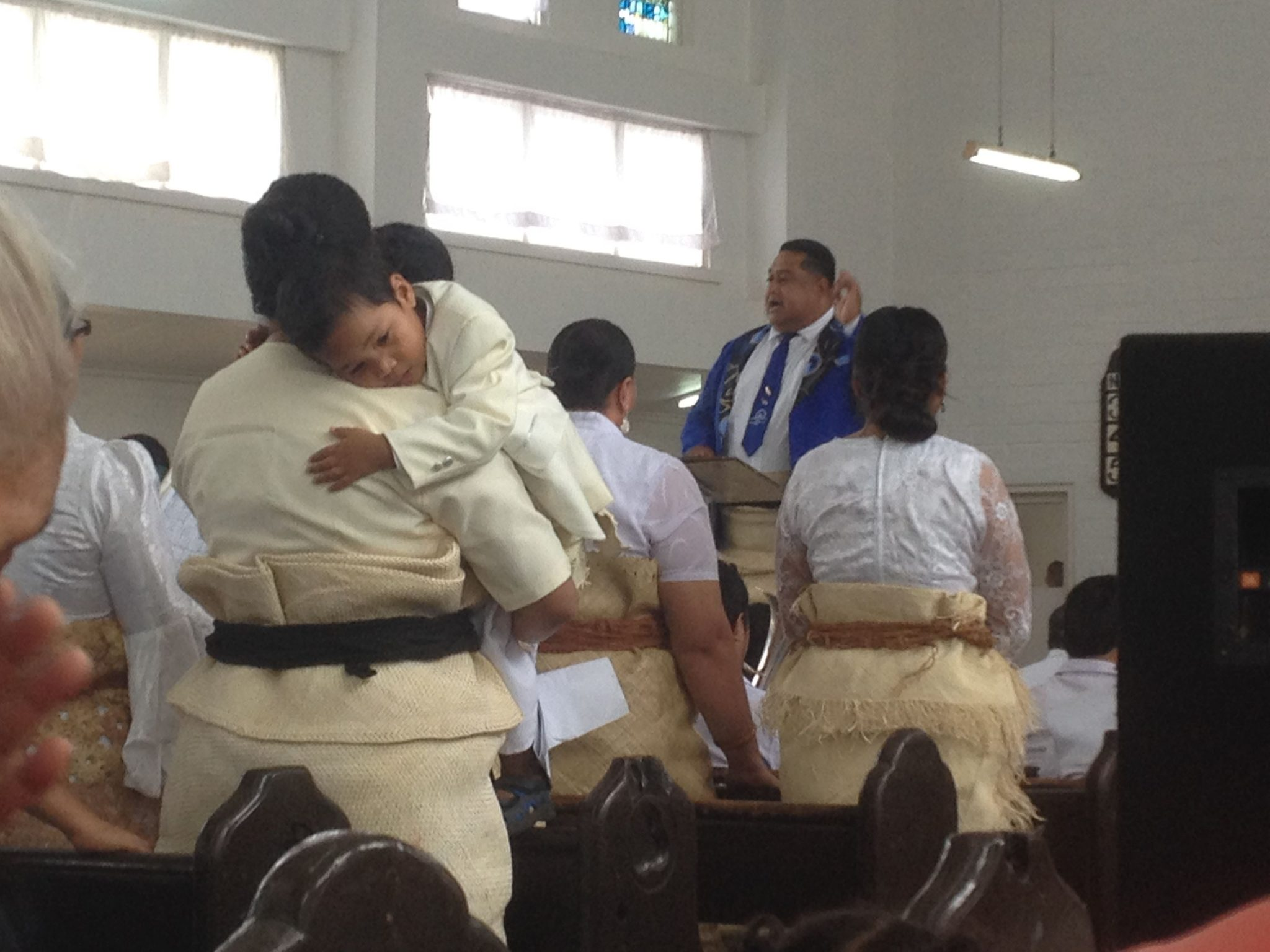 9. The young lad became sleepy and his mother, a member of one of the choirs, came to the rescue! Tongan men and women, children and teens chose to show their allegience to the crown of Tonga by wearing the traditional woven wrap