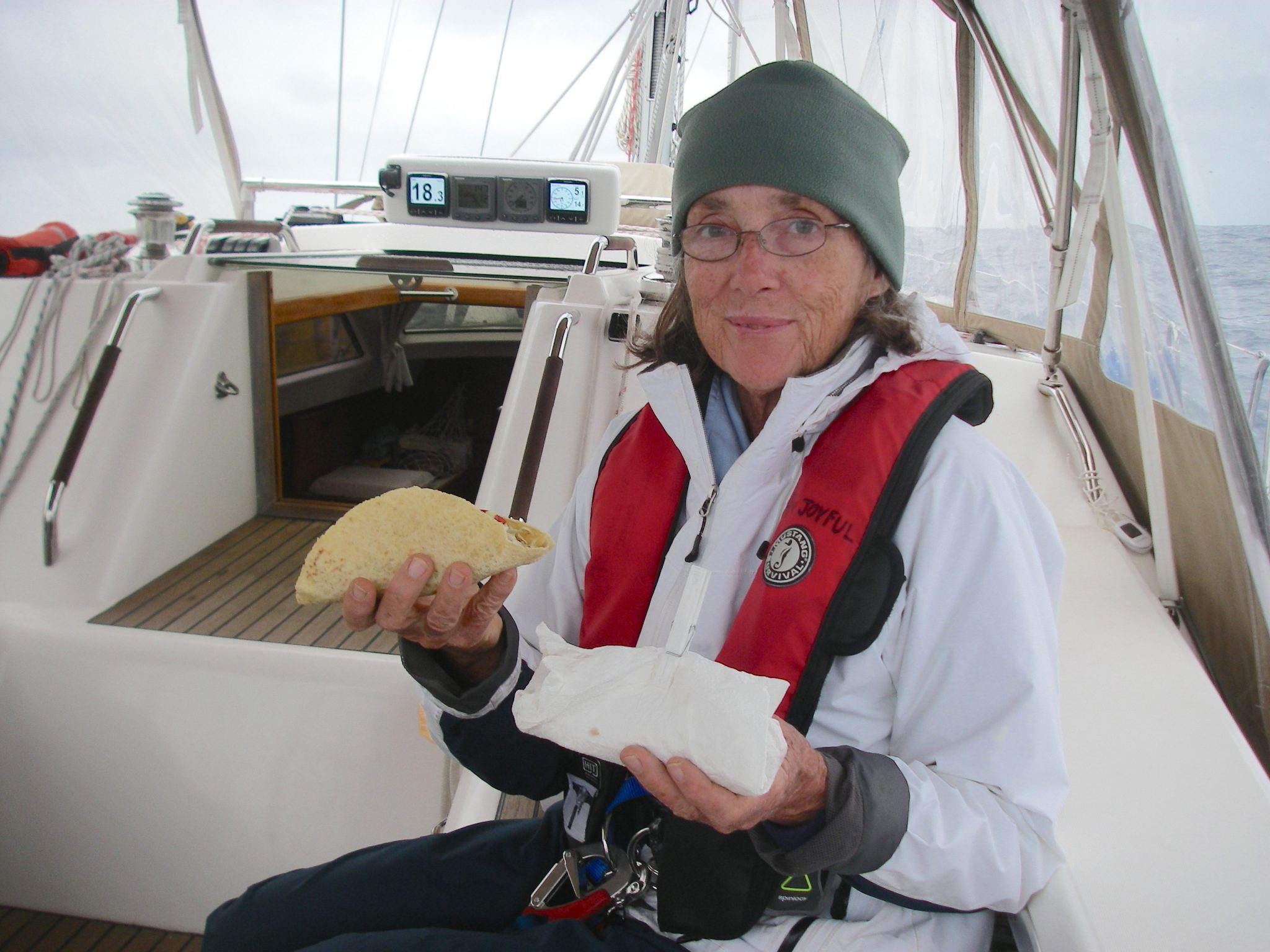 10. Eating lunch underway in 18 knots of wind can be challenging. So one way is to serve tacos in a paper towel closed with a clothes pin It worked well, and Joyful was happy...no mess