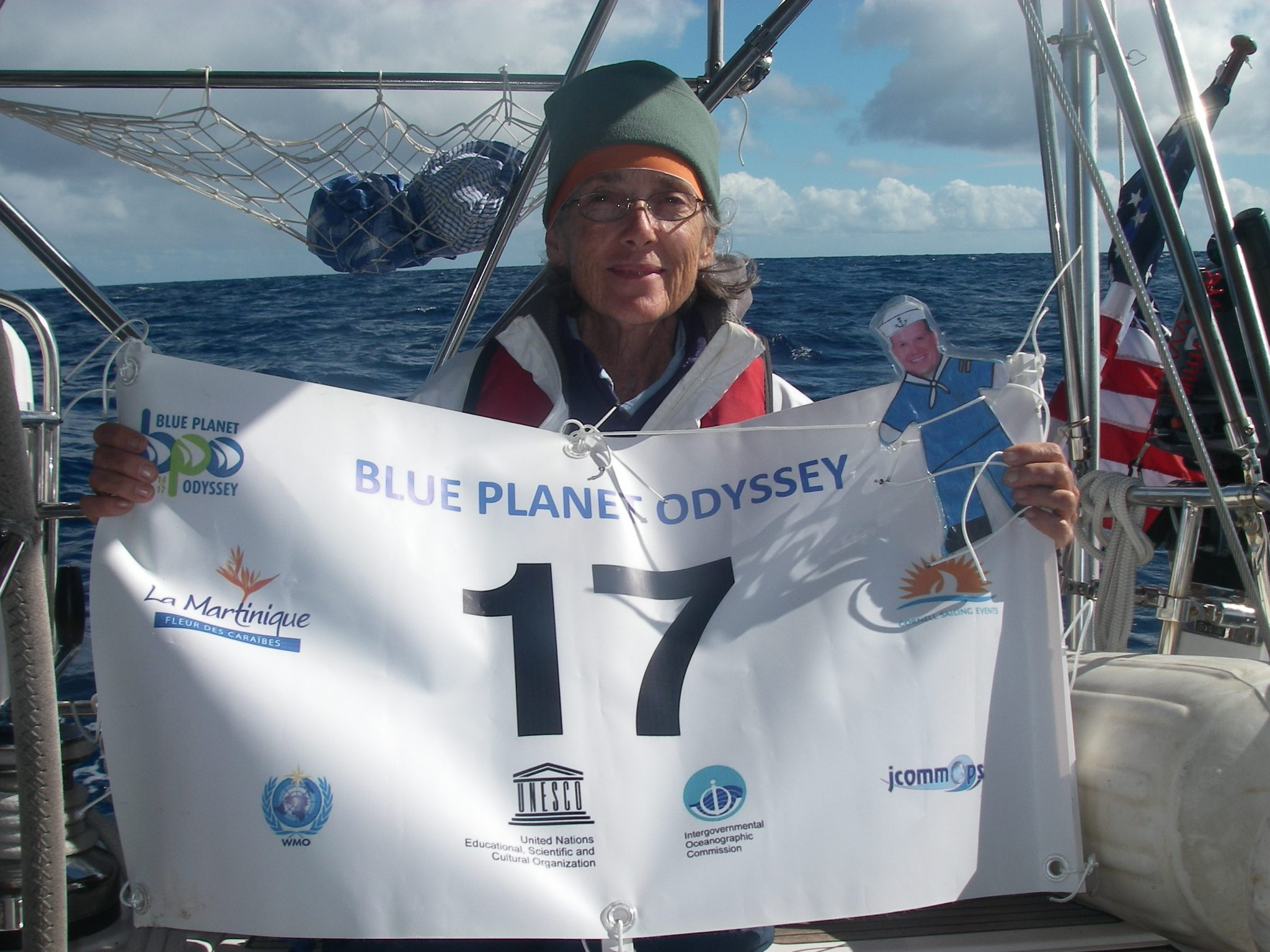 18. Flat Mr. Davis and Anne display Joyful's new number Jimmy Cornell assigned her for the Blue Planet Odyssey. He gave all the boats a new number. Joyful's old number was 20