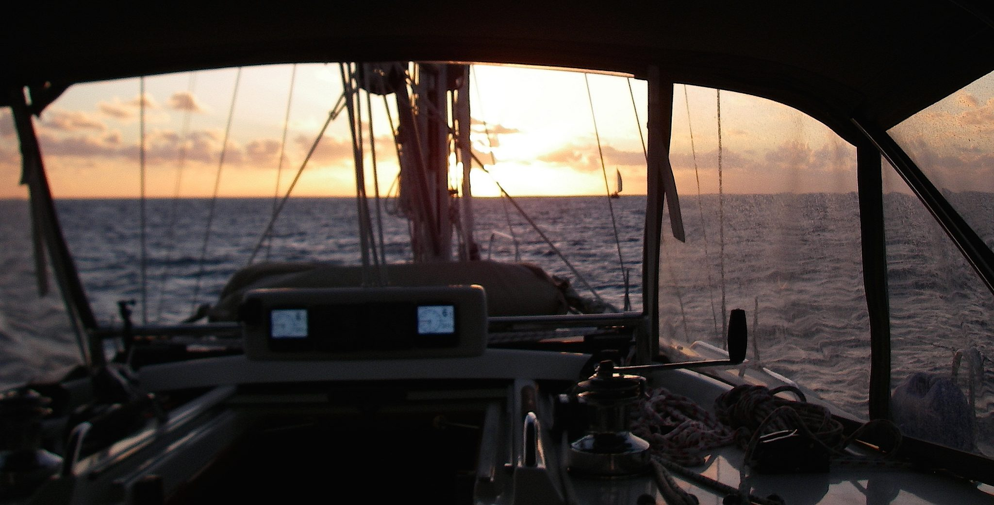 3. Joyful's passage to Vanuatu began with a gorgeous Tongan sunset. If you look closely, you can see another sail boat on the horizon to starboard of Joyful's bow