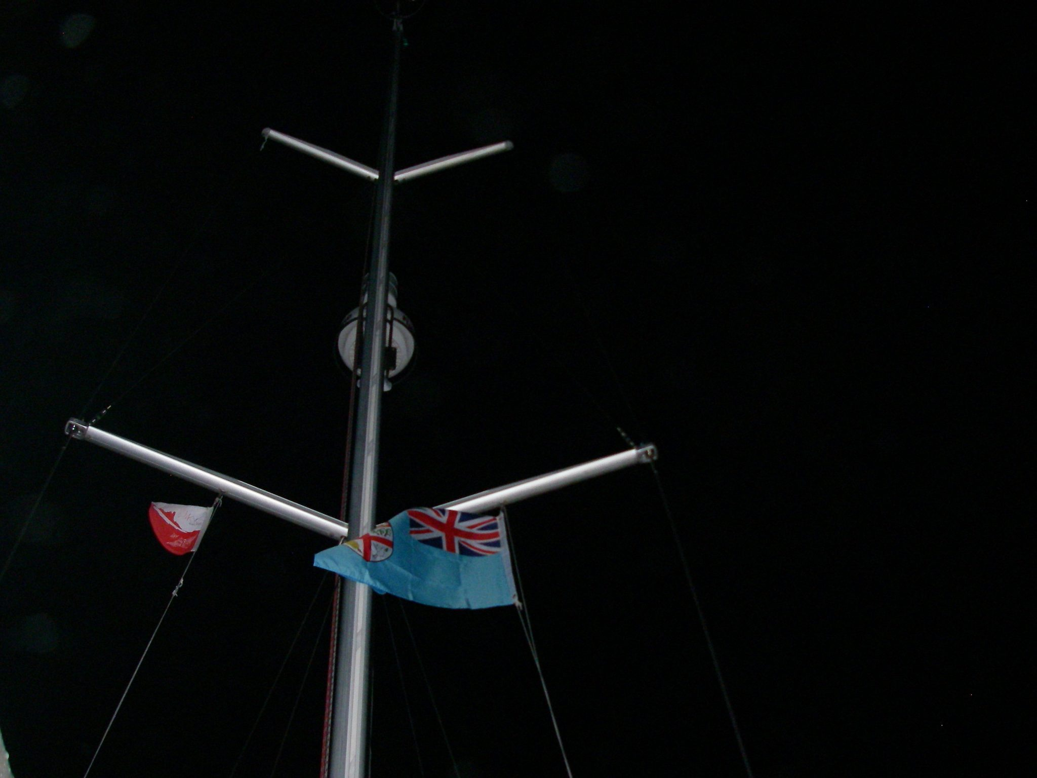 39. The Fiji courtesy flag and the MaiKai Yacht Club of Bora Bora pennant fly straight out in the strong winds