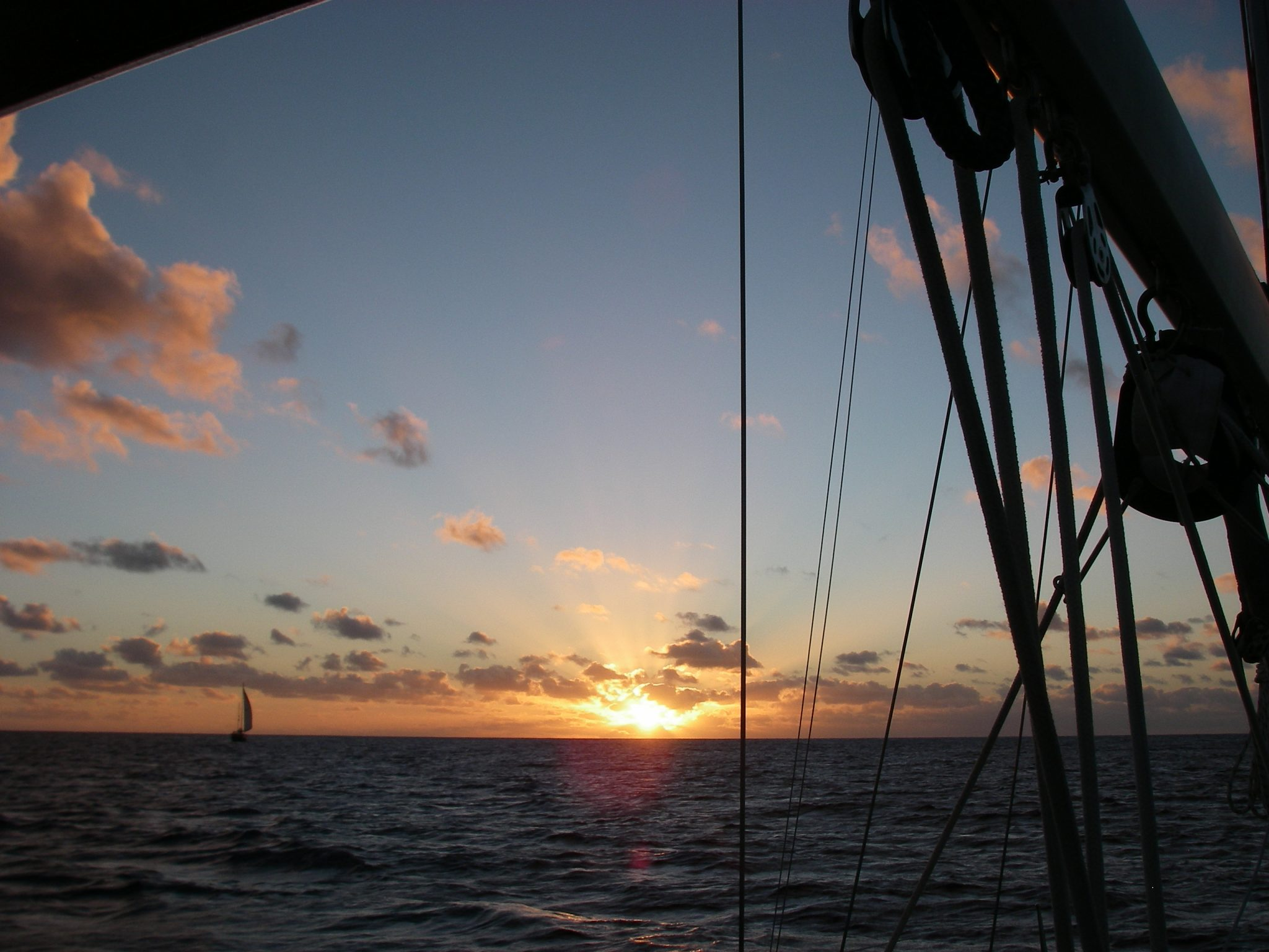 4. As we sailed away from Tonga, bound for Vanuatu, a gorgeous sunset welcomed us to sea! Another sailboat was heading for sea, as well as Joyful