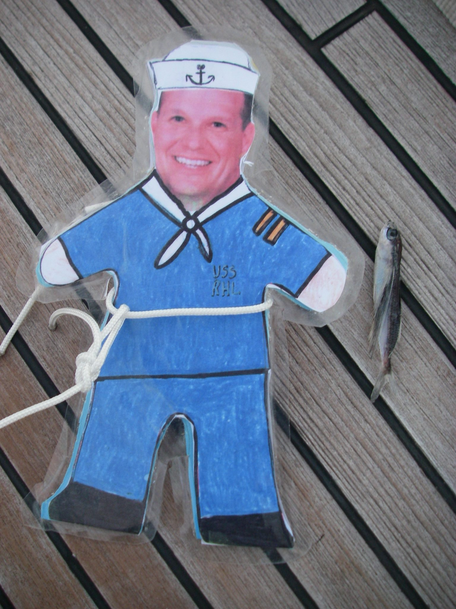 58. Flat Mr. Davis found a flying fish that landed on Joyful's deck in the morning we sailed into Vanuatu