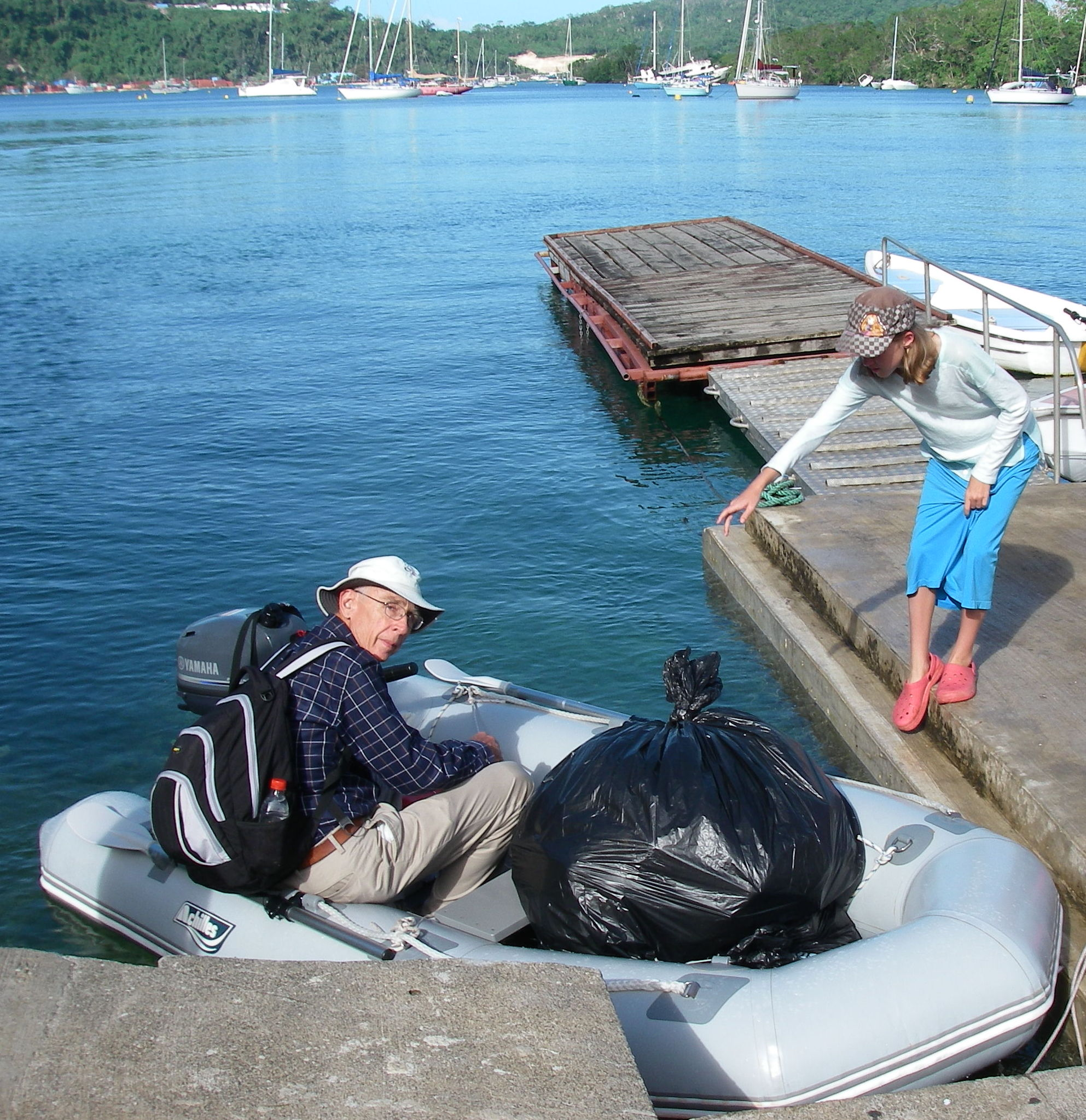 11-jeff-brought-many-bags-full-of-art-and-school-supply-kits-from-joyful-to-the-dinghy-dock-the-morning-of-the-art-lesson-young-faith-helped-take-the-painter-from-jeff