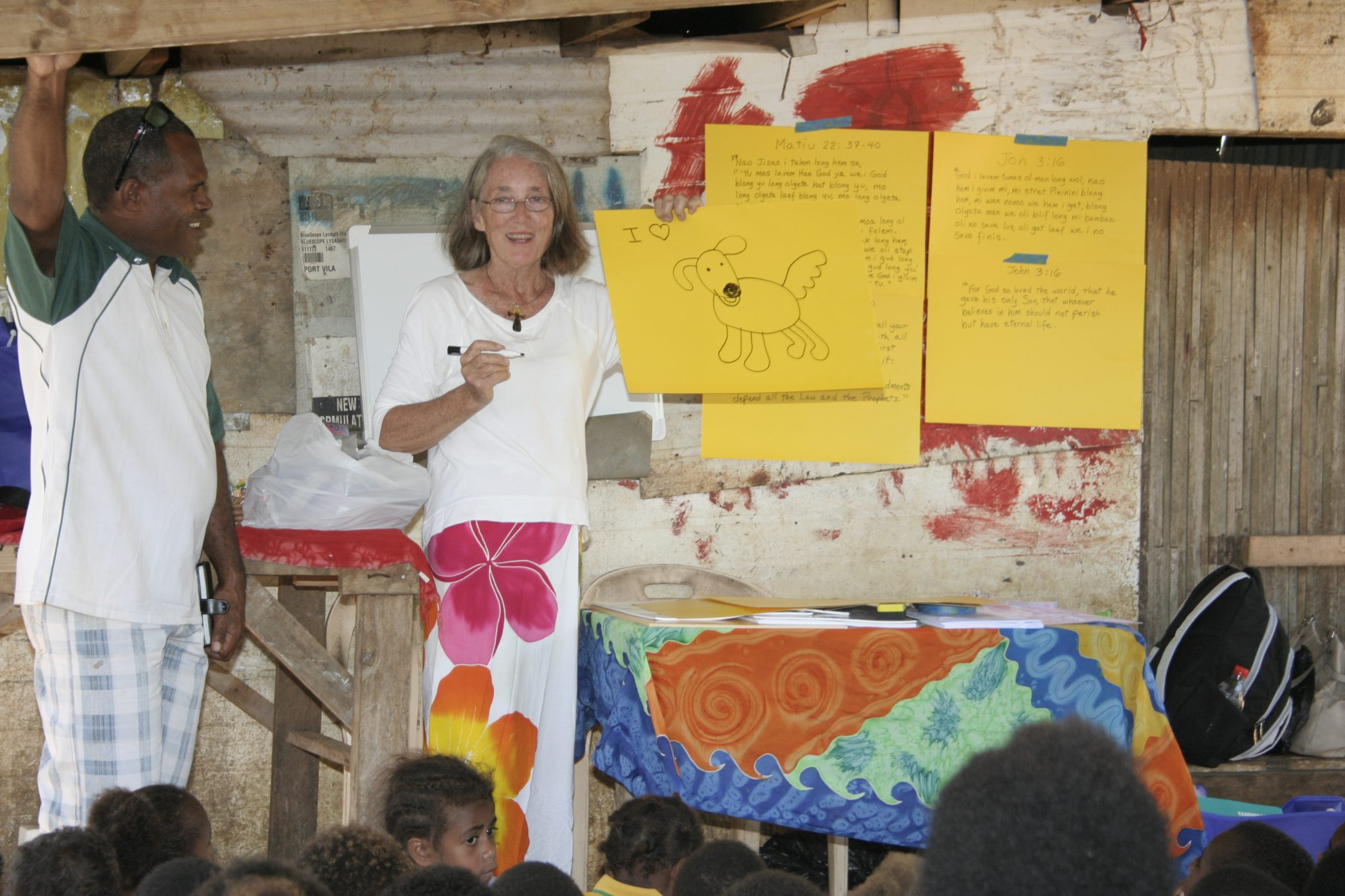 45-willy-a-leader-in-tagabe-village-helped-translate-into-bislama-while-anne-taught-about-jesus-through-an-art-lesson-to-141-children-jeff-assisted-by-purchasing-and-assembling-the-art-and-school