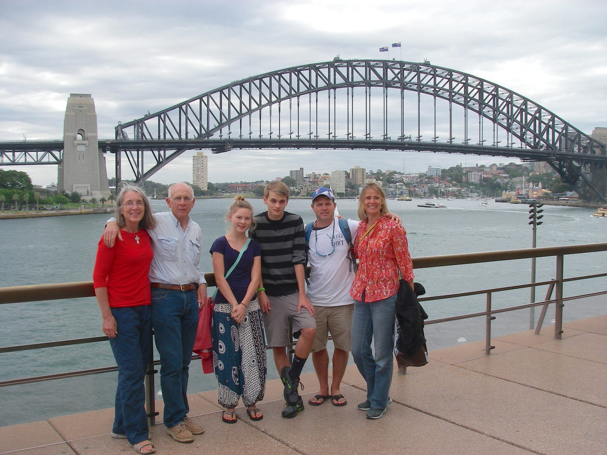 101.3. Six of the Sailors for Christ members, as we named ourselves and other sailing missionary families we met in Bora Bora, pose for a photo in front of the Sydney Bay Bridge