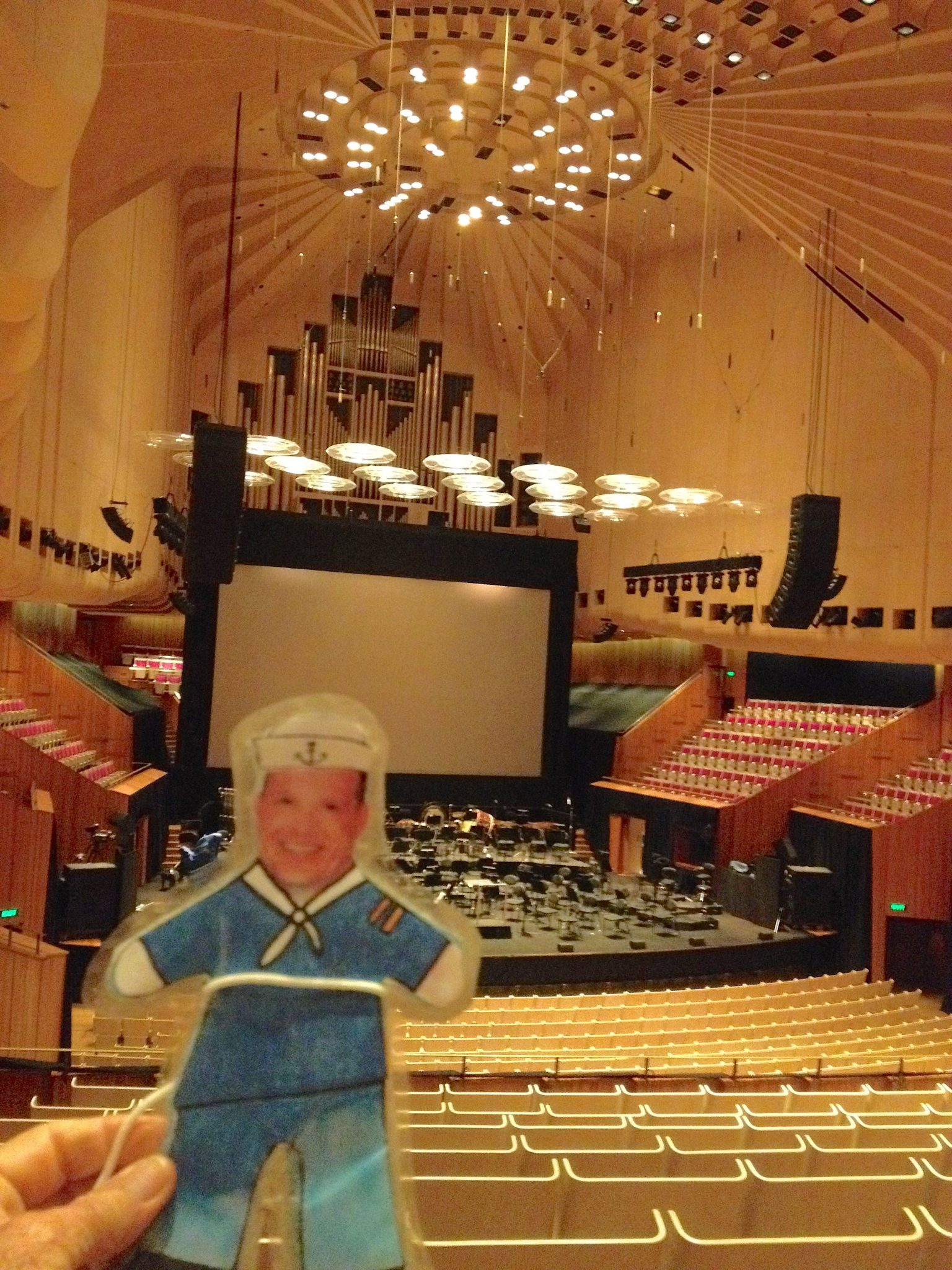 110. Flat Mr. Davis could have his photo taken in the concert hall because it was between events