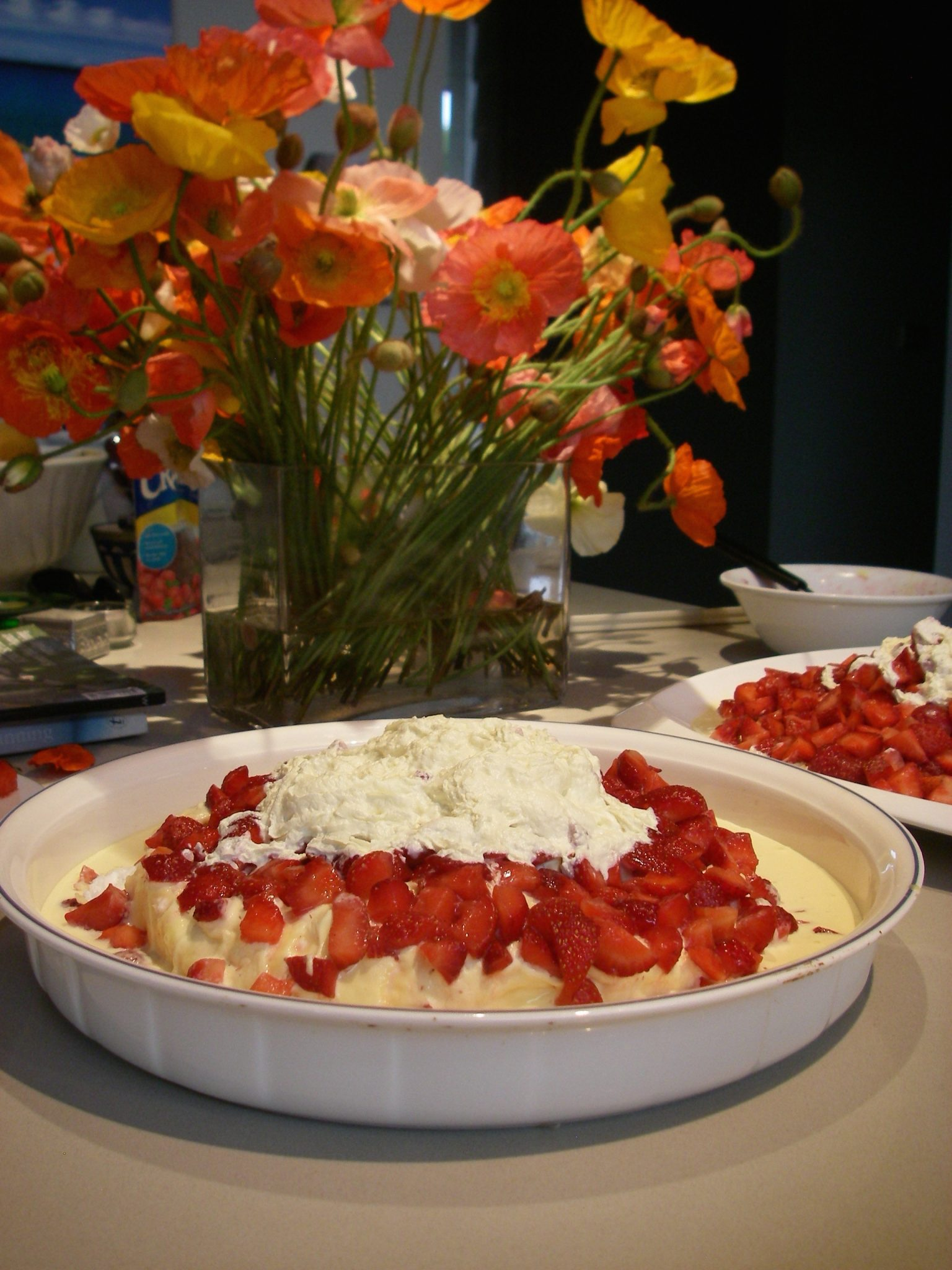 115. For Thanksgiving, we enjoyed a traditional Australian dessert called a Pavlova. It is a marangue covered with double cream and fruit with whipped cream on top! It was extraordinar