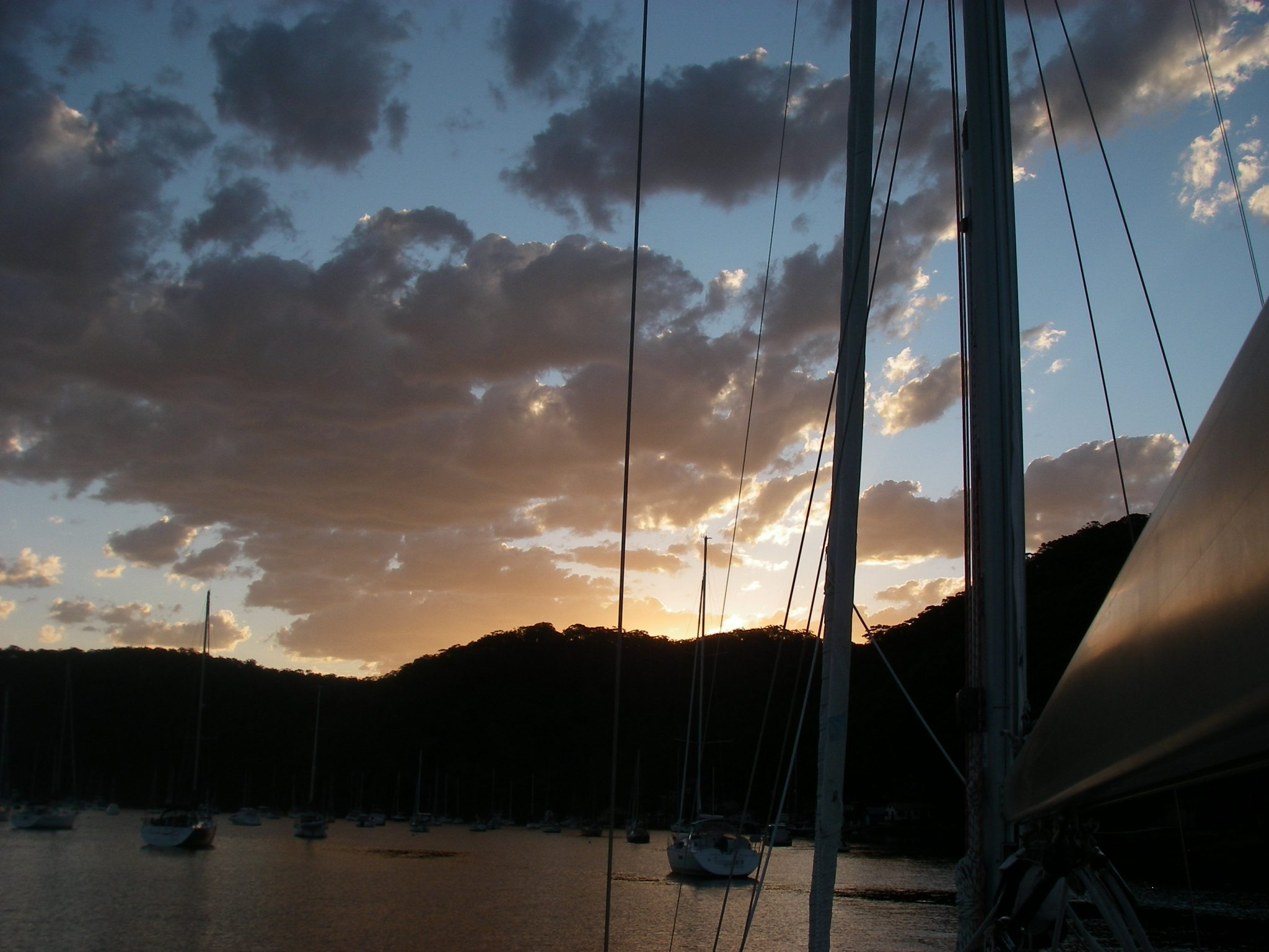 12. Pittwater sunset reflected in Joyful's boom.JPG