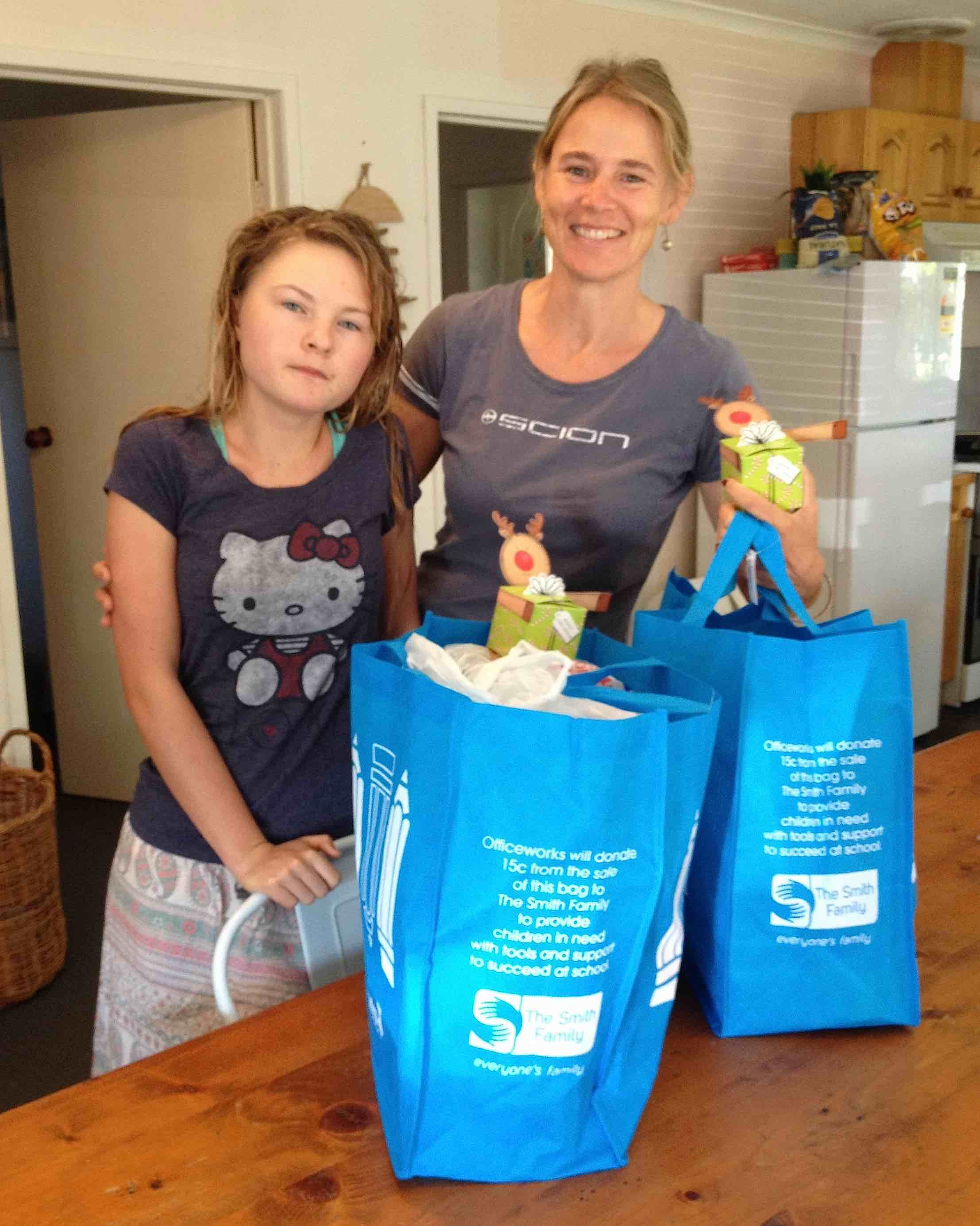 121. Beatrice and Gabriella with the Christmas presents they helped assemble that we gave the residents of the Banfield Aged Care Center on Phillip Island.