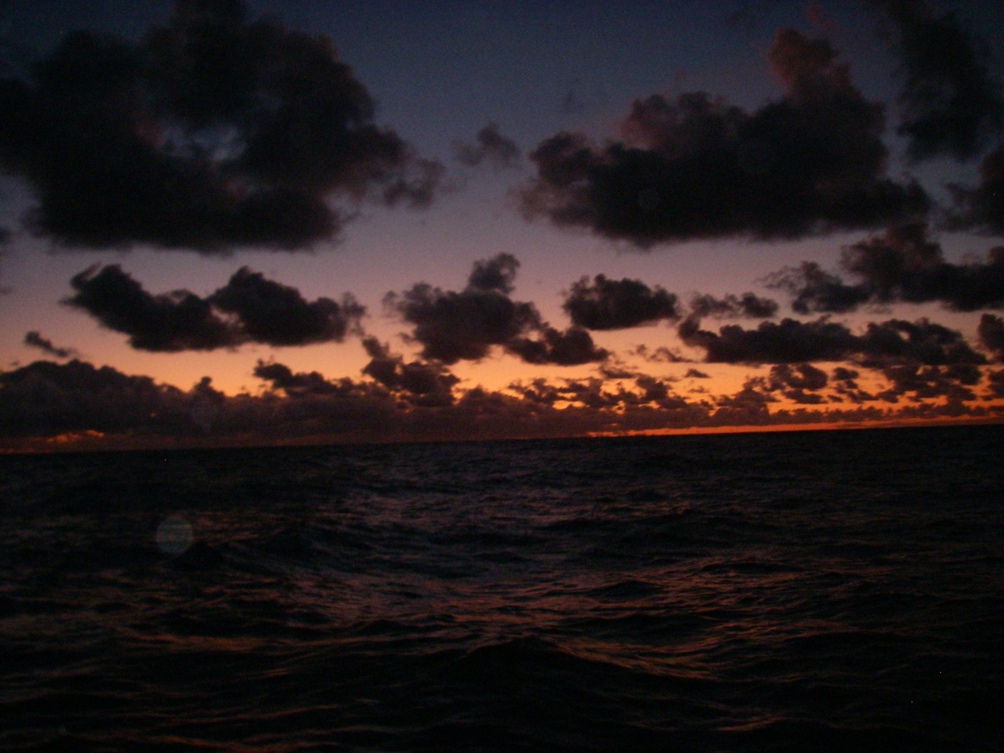 40.3. This is the first of a three photo series of the same sunrise in the Tasman Sea, a few miles off the coast of Eastern Australia. Sunrises at sea were such a delight! They changed