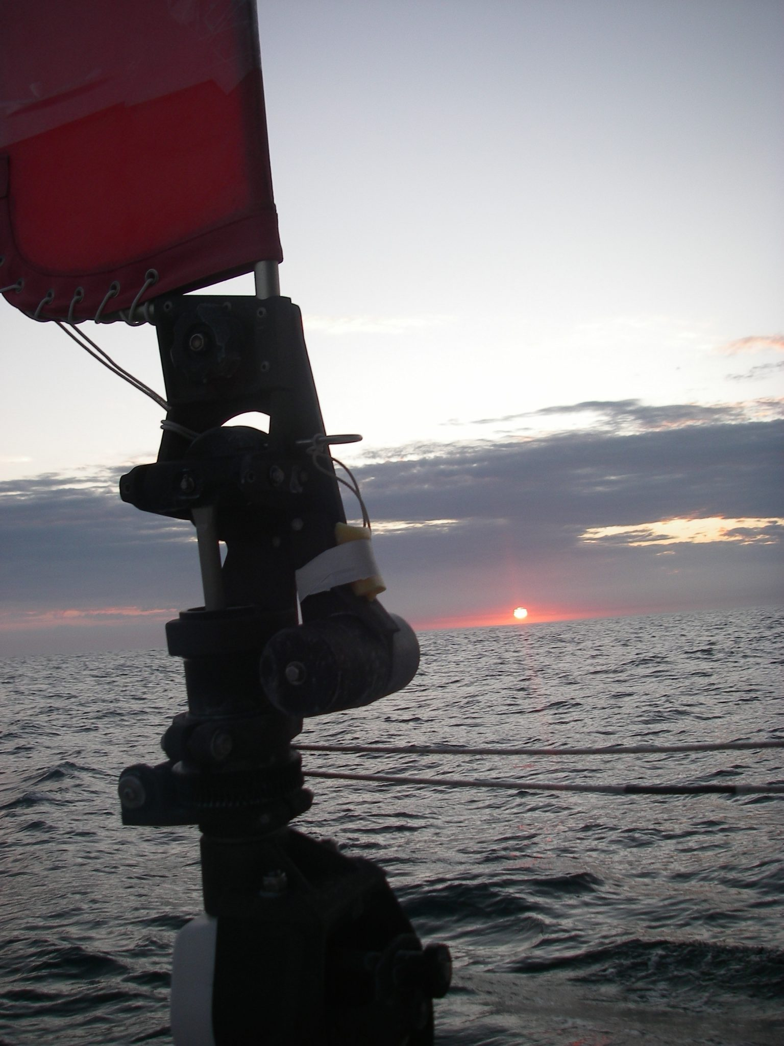 6.1. Sunrise from Joyful's cockpit on the Coral Sea.