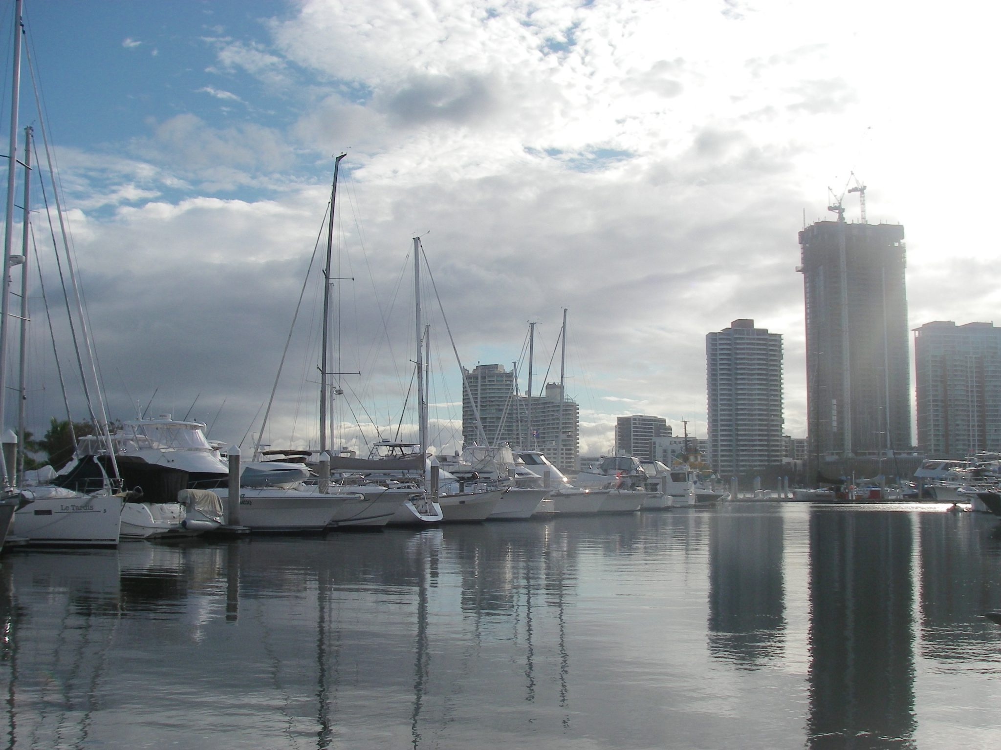 8.5. Southport Yacht Club with skyscraper condominiums in the distance. You can see Joyful's two foresails close together and her Australian courtesy flag flying
